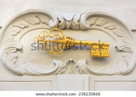 Gold key, house motif above the main door on Nerudova street (Royal Way or Kings Road). Prague, Czech Republic - stock photo