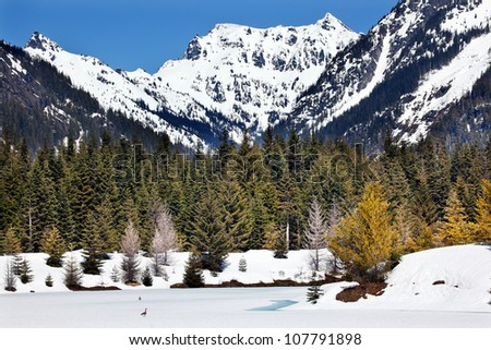 Gold Lake Chikamin Peak Snoqualme Pass Spring Snow Wenatchee National Forest Wilderness Washington - stock photo