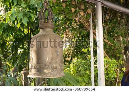 Gold large bell from a temple in Thailand - stock photo