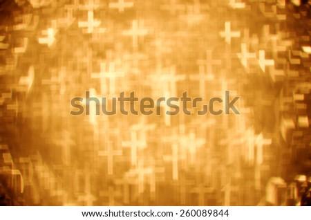 gold latin cross bokeh background - stock photo