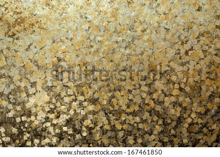Gold leaf on Thai temple wall - stock photo