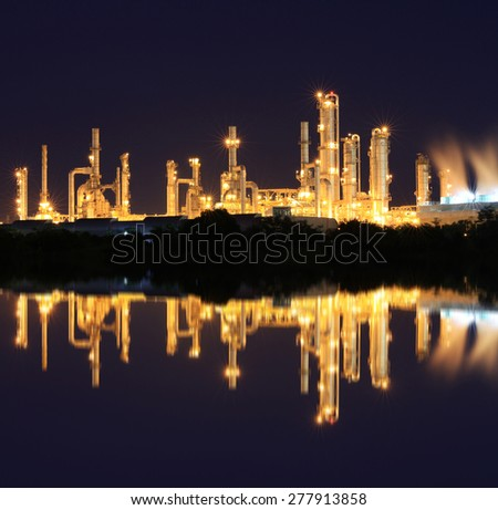 Gold light of petrochemical industry reflection - stock photo