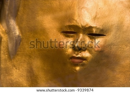 gold mask from venice - sun