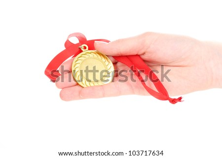 Gold medal in hand isolated on white - stock photo