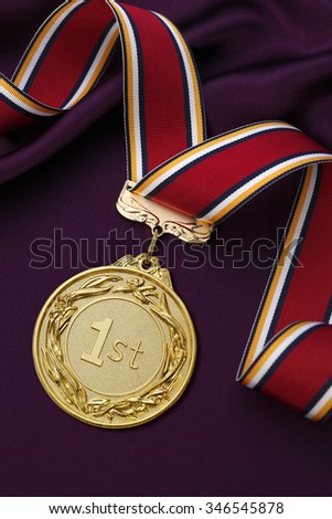 Gold medal on a Purple satin background - stock photo