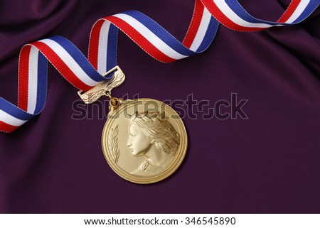 Gold medal on a Purple satin background