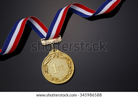 Gold medal on black background?