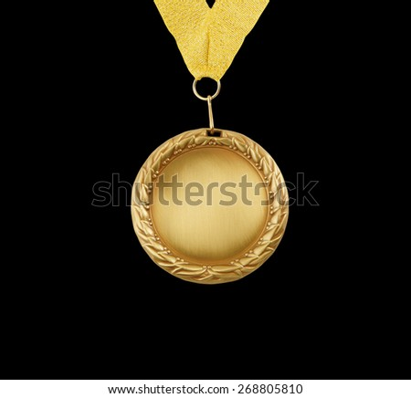 Gold medal with golden ribbon isolated on black