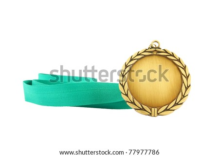 Gold medal with green ribbon isolated on white - stock photo