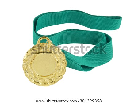 Gold medal with green ribbon isolated on white background - stock photo