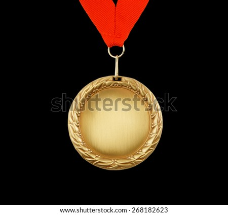 Gold medal with red ribbon isolated on black