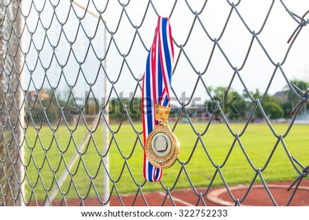 gold medal with ribbon, Hanging on the fence.