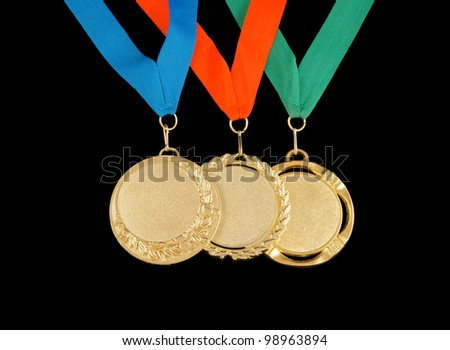 Gold medals isolated on black