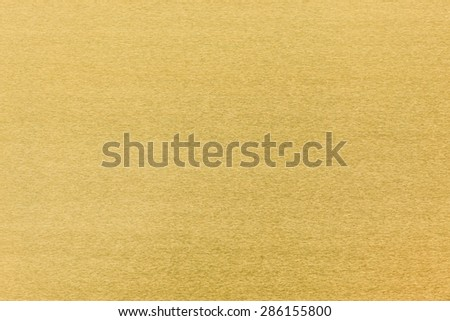 Gold metal alloy texture close up, made from gold silver and copper bronze for background - stock photo