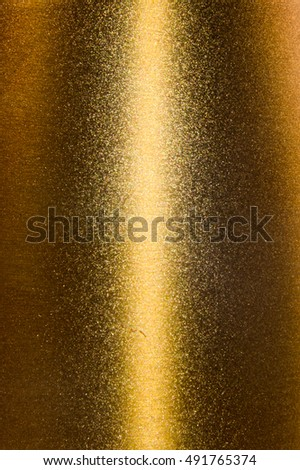Gold metal background brushed metallic texture with reflections.