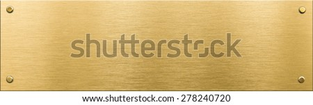 gold metal plaque or nameboard with rivets  - stock photo