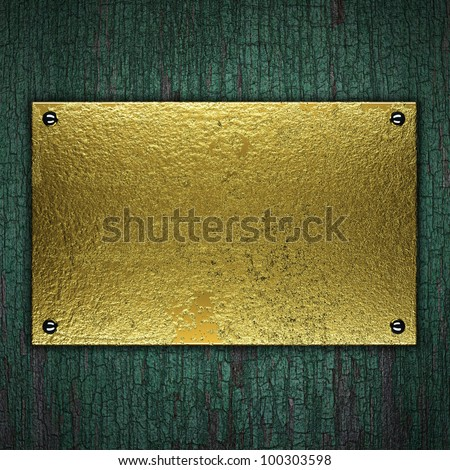 gold metal plate on wooden background
