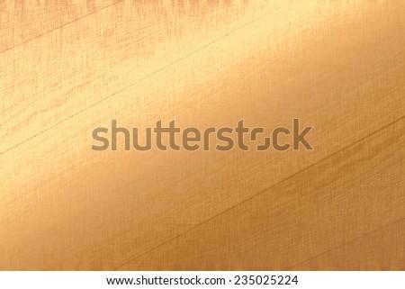 Gold metallic background, golden foil, fabric texture, pastel background  - stock photo