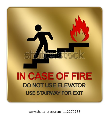 Gold Metallic Style Plate For In Case Of Fire Do Not Use Elevator Use Stairway For Exit Sign Isolated on a White Background - stock photo