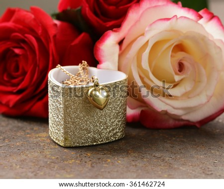 gold necklace heart with roses flowers for gift - stock photo