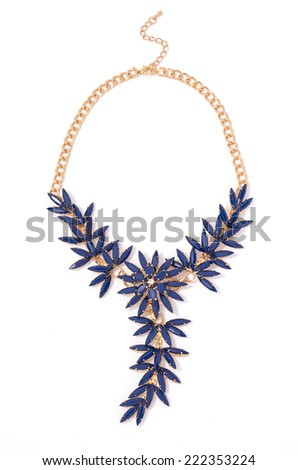 gold necklace with blue flowers on a white background - stock photo