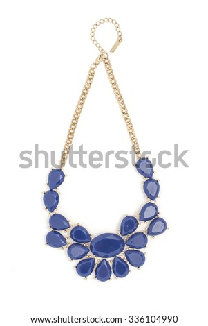Gold necklace with blue stones isolated on white - stock photo