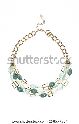 gold necklace with green gems on a white background - stock photo