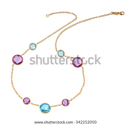 gold necklace witn precious stones - stock photo