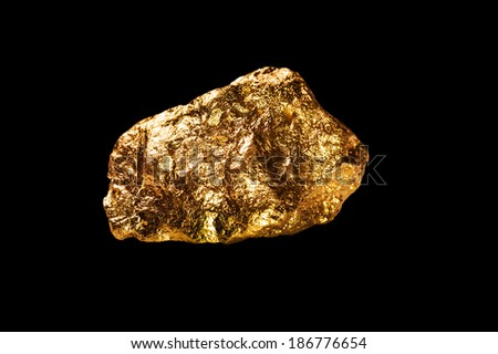 Gold nugget isolated on black background. - stock photo