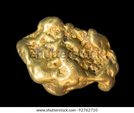 Gold nugget isolated on black. This is real. - stock photo