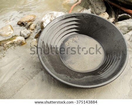 Gold Nugget mining from the River in Austria, real Gold. - stock photo
