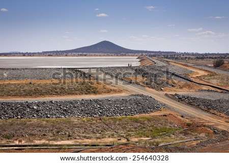 Gold ore slurry pit. Barrick Cowal Gold Mine in New South Wales,  Australia.  - stock photo