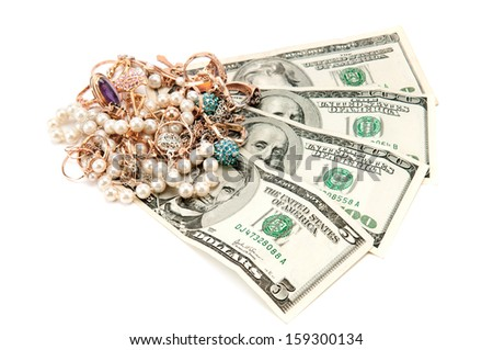 Gold ornaments and dollars isolated on a white background - stock photo