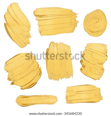 Gold paint stokes isolated on white background - stock photo