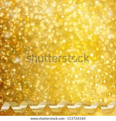 Gold paper horizontal ribbon on abstract snowy background fetti - stock photo