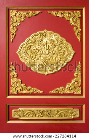 Gold Pattern temple wall Red Background in Thailand.