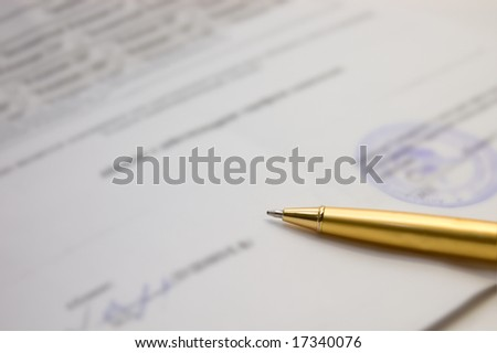 Gold pen on contract