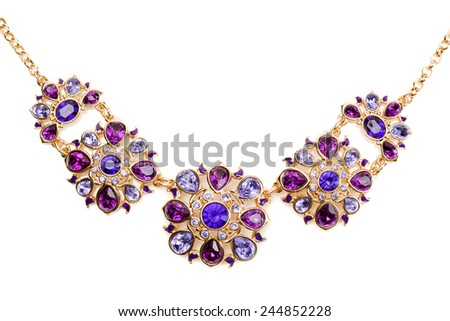 Gold pendant with blue and purple stones. Isolate on white. - stock photo