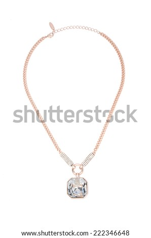 gold pendant with stone on a white background - stock photo