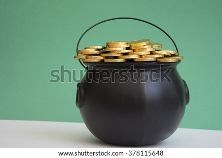 gold piled in caldron for st. patricks day - stock photo