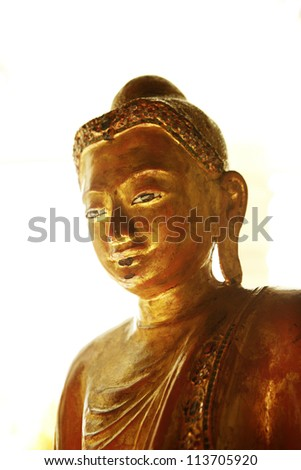 gold plated buddha figure with copyspace