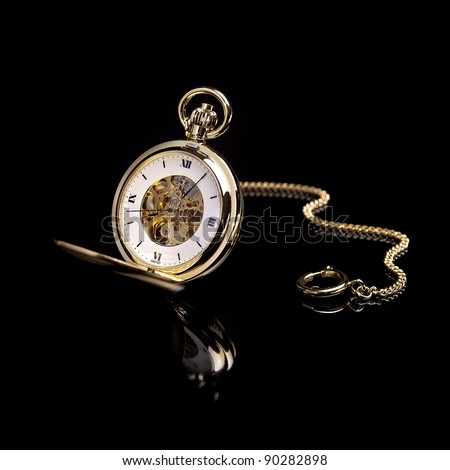Gold pocket watch on a black background - stock photo
