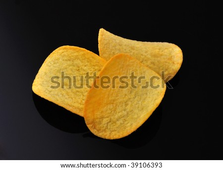 Gold potato chips isolated - stock photo