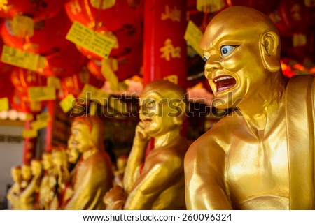 Gold priest statue in Chinese temple - stock photo