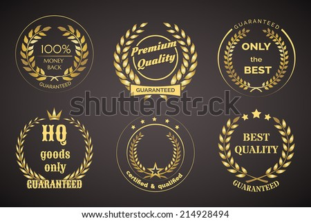 Gold Retro Guarantee Labels with Wreaths Isolated on Black Background. - stock photo