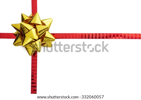Gold ribbon bow on red ribbon isolated on white with space
