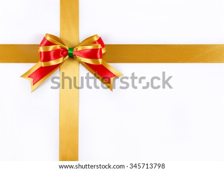 Gold ribbon with gold & red ribbon bow isolated on white