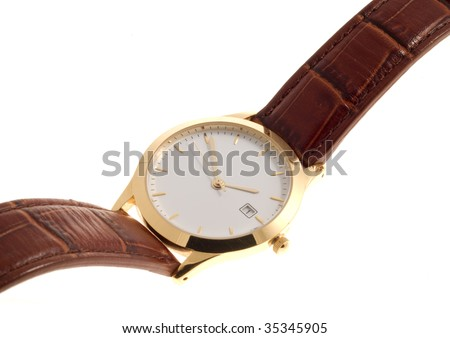 Gold-rimmed wrist watch with brown leather strap.