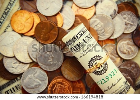 Gold ring and money. - stock photo