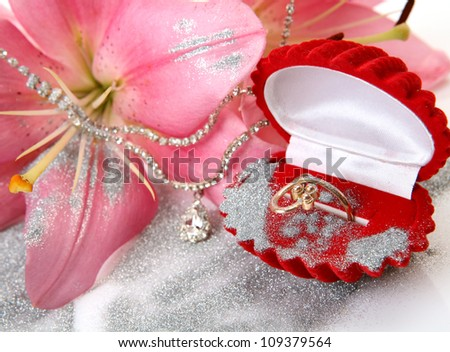 Gold ring and pink lilies
